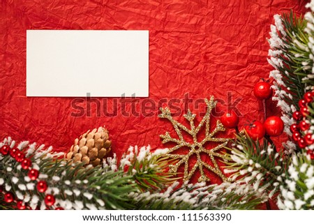 Frame from Christmas tree decorations on red paper with blank