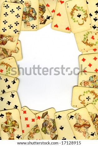 Frame from old playing cards on white background