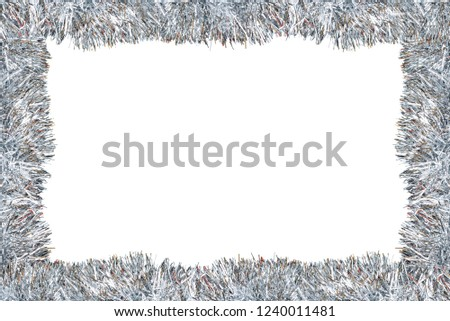 Frame made from silver tinsel decorations for christmas, isolated on white background with clipping path and copy space. #1240011481