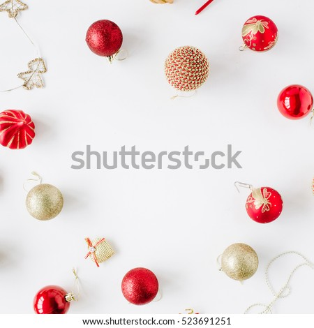 frame made of christmas decoration with christmas glass balls, tinsel, bow. christmas wallpaper. flat lay, top view #523691251