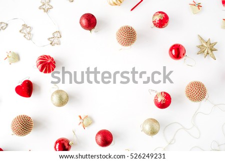 frame made of christmas decoration with christmas glass balls, tinsel, bow. christmas wallpaper. flat lay, top view #526249231