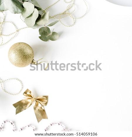 frame made of christmas decoration with christmas glass balls, tinsel, bow, eucalyptus. christmas wallpaper. flat lay, top view