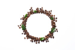 Frame made of fresh green coffee leaves and beans on white background, top view. Space for text