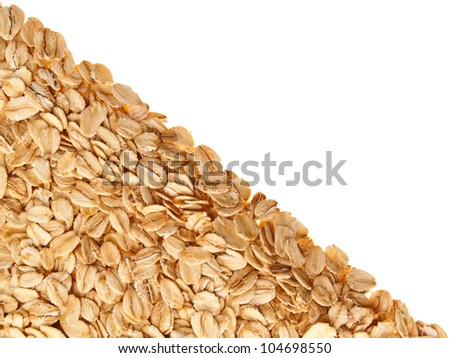 Frame made of oatmeal, laid diagonally. On a white background.