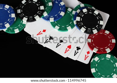 frame made of playing cards and poker chips on black background close-up