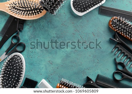 Frame made of professional hairdresser's tools on color textured background #1069605809