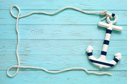 Frame made of rope with an anchor.  Summer time sea vacation concept. Place for your text.