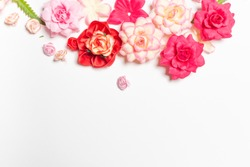 Frame made of rose flowers on white background. Top view with copy space. Flat lay design concept.