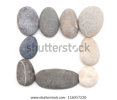 frame made of sea stones isolated on white background