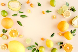 Frame made of summer tropical fruits: orange, lemon, lime, mango on yellow background. Food concept. flat lay, top view