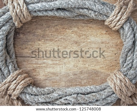 frame made of twisted rope on a wooden background