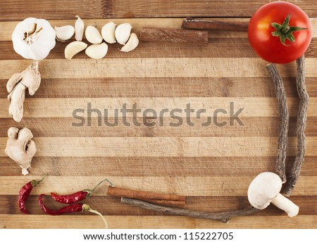 frame made of vegetables and spices on a used cutting board