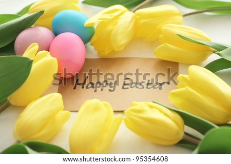 Frame made up of tulips and easter eggs,Happy easter.