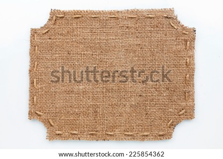Frame of burlap, lies on a white background, can be used as texture