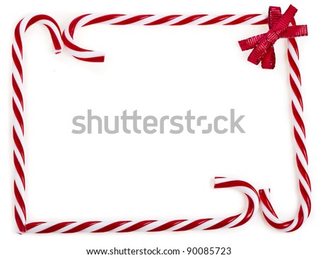 frame of christmas lollipop cane isolated on white