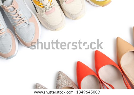 Frame of different shoes on white background, top view with space for text #1349645009