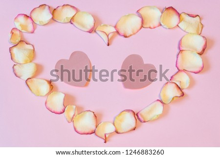 Frame of dried cream rose petals in heart shape with two pink paper hearts on pastel background. Love, romance or Valentine's day concept, mock up. Flat lay, copy space, top view #1246883260
