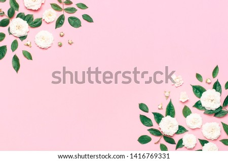 Frame of Flowers composition. White fresh roses and green leaves on gentle pink background. Flat lay, top view, copy space. Flower card, greeting, holiday mockup. Valentine's Day background womens day #1416769331