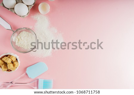 Frame of food ingredients for baking on a gently pink pastel background. Cooking flat lay with copy space. Top view. Baking concept. Mockup. #1068711758