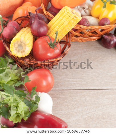 frame of fresh vegetables on a wooden background