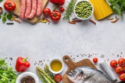 Frame of ingredients for cooking Italian pasta and fish, meat and vegetables. The concept of healthy food with home delivery. Top view, place to copy.