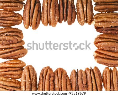 Frame of peeled pecan nuts close up, isolated on white background