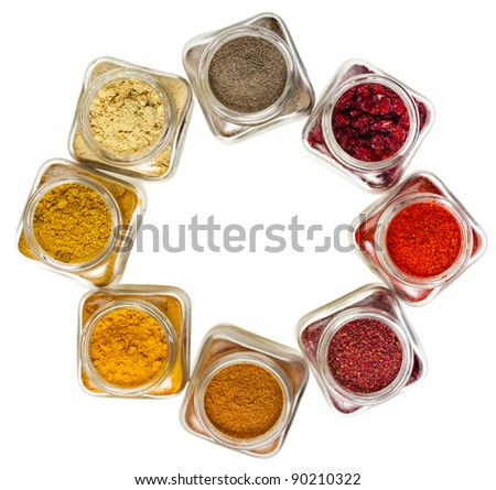 frame of powder colorful spices in glass bottle, top view,  isolated on white background