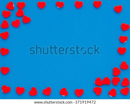Frame of red hearts on blue background #371919472