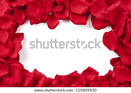 Frame of red rose petals on white background