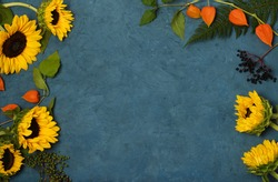 Frame of sunflowers on blue background