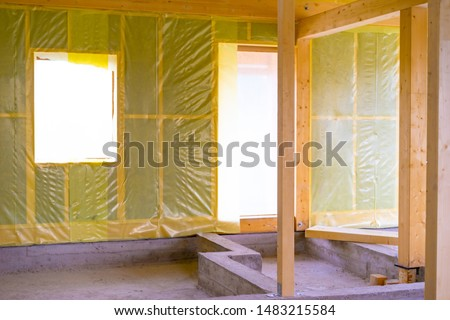 Frame of the cottage with insulation.Walls covered with insulation. Services for the insulation of houses.Soundproofing.Finishing work in a house made of wood. Glued beam cottage.Construction company