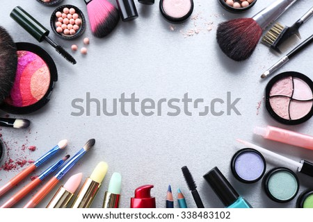 Frame of woman\'s decorative cosmetics on light background