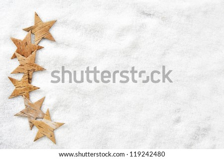 frame of wooden stars lying in snow