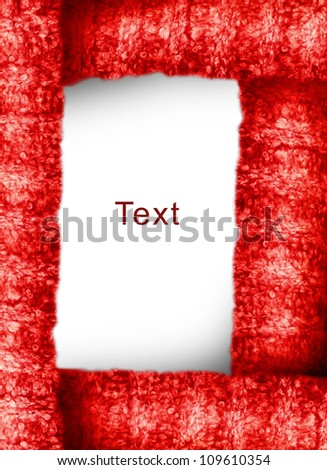 frame of wool fabric warm soft red in four rows with the place backdrop for your text