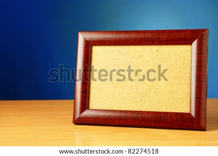 frame on a wooden table and a beautiful backdrop