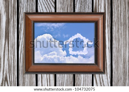 frame on the wooden wall - stock photo
