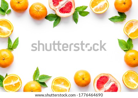 Frame sliced citrus mix white background top view
