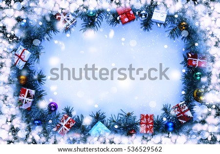 Frame. Toned image. Christmas background with decorations and gift boxes on wooden board #536529562
