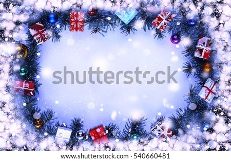 Frame. Toned image. Christmas background with decorations and gift boxes on wooden board #540660481