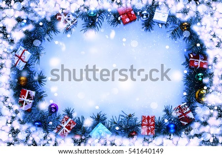 Frame. Toned image. Christmas background with decorations and gift boxes on wooden board #541640149