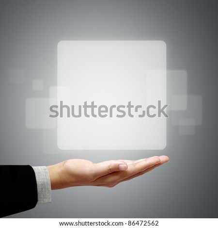 Frame white square above the business hand on a gray background.