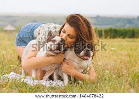 Frame with a beautiful girl with a beautiful dogs outdoor on green grass. stock photo