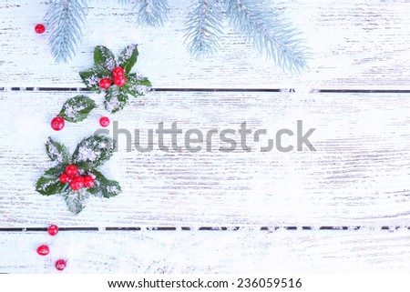 Frame with European Holly (Ilex aquifolium) with berries on wooden background #236059516