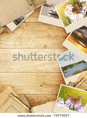 Frame with old paper and photos. Objects over wooden planks