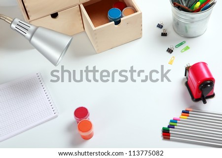 Frame with school accessories on the desk