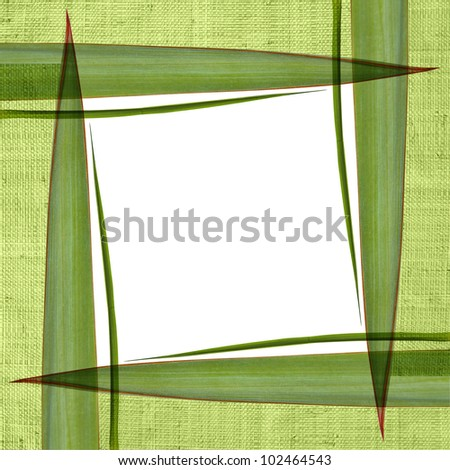 Frame with straw and green leaves