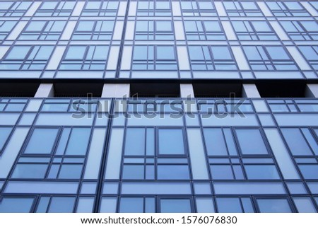 Framed hi-tech glass structures. Structural glazing. Transparent wall of an office building with metal framework. Abstract modern architecture or technology background.