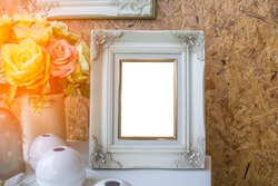 Frames white vintage style on the table white on wood background.