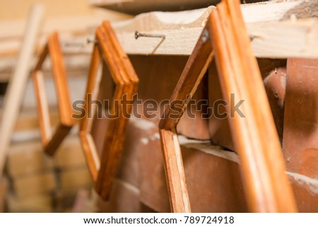 Framework for photos. A wooden framework for photos hangs dries. Hand-made articles from a tree.