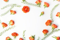 Framework from orange roses on white background. Flat lay. Top view